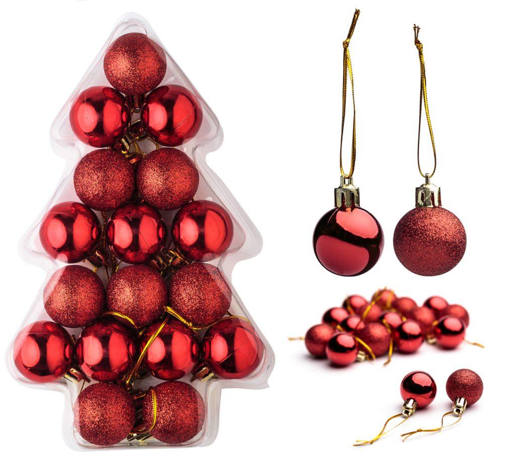 Set de bolas de navidad de color rojo en caja con forma de árbol.
