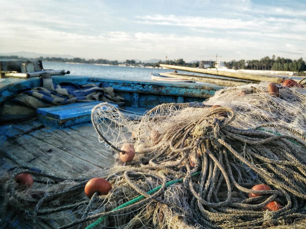 Pescadores recogida de plástico. Toalla Reciclada